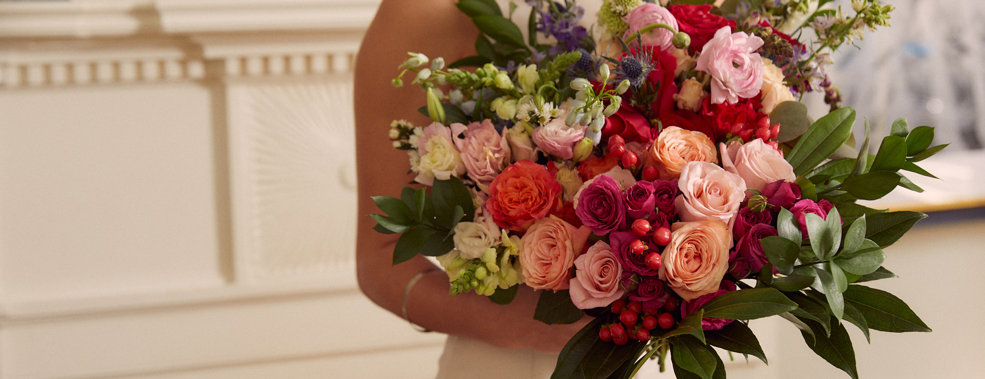 Bride holding wedding flowers in unique fall colors