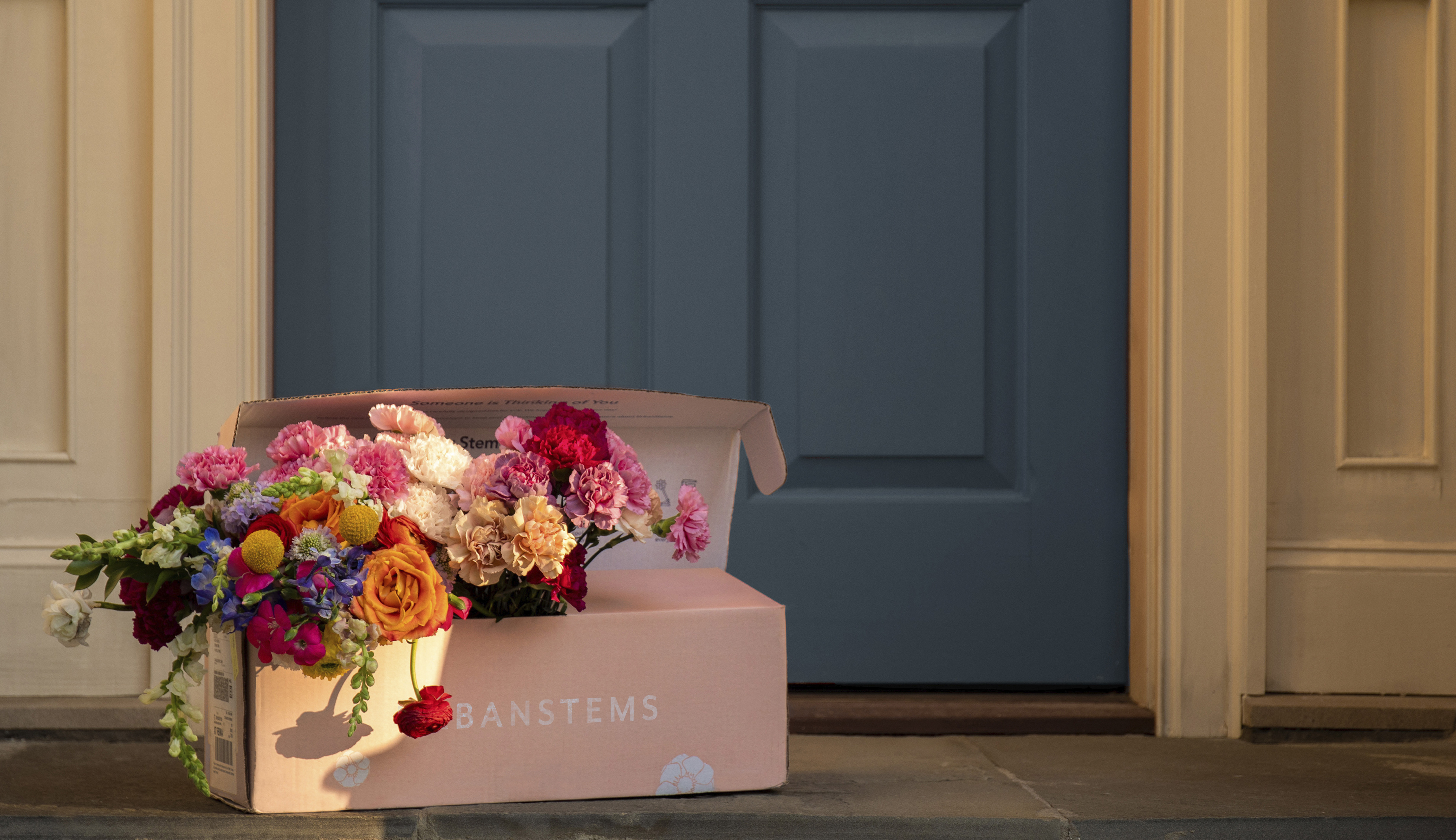 Floral bouquet in same-day deliver box on doorstep