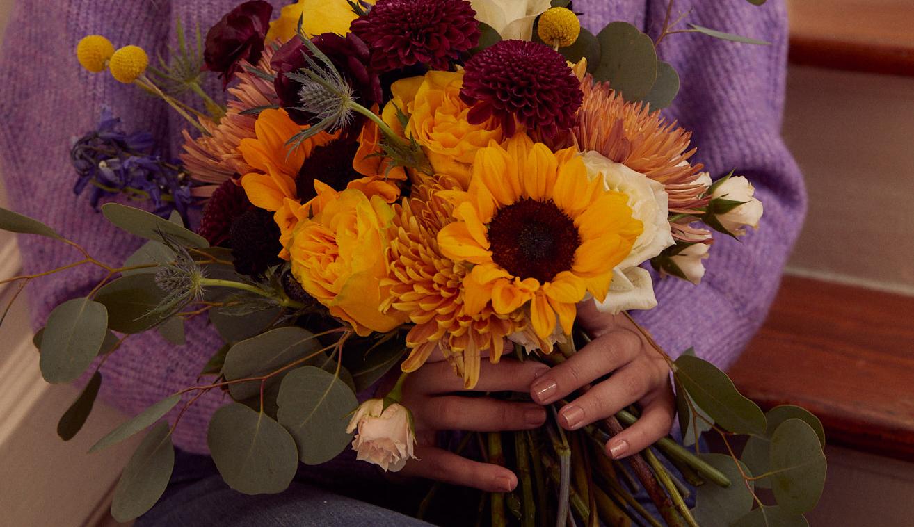 Floral wedding arrangement with unique fall colors