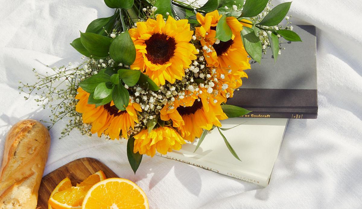 Sunflower bouquet on picnic blanket