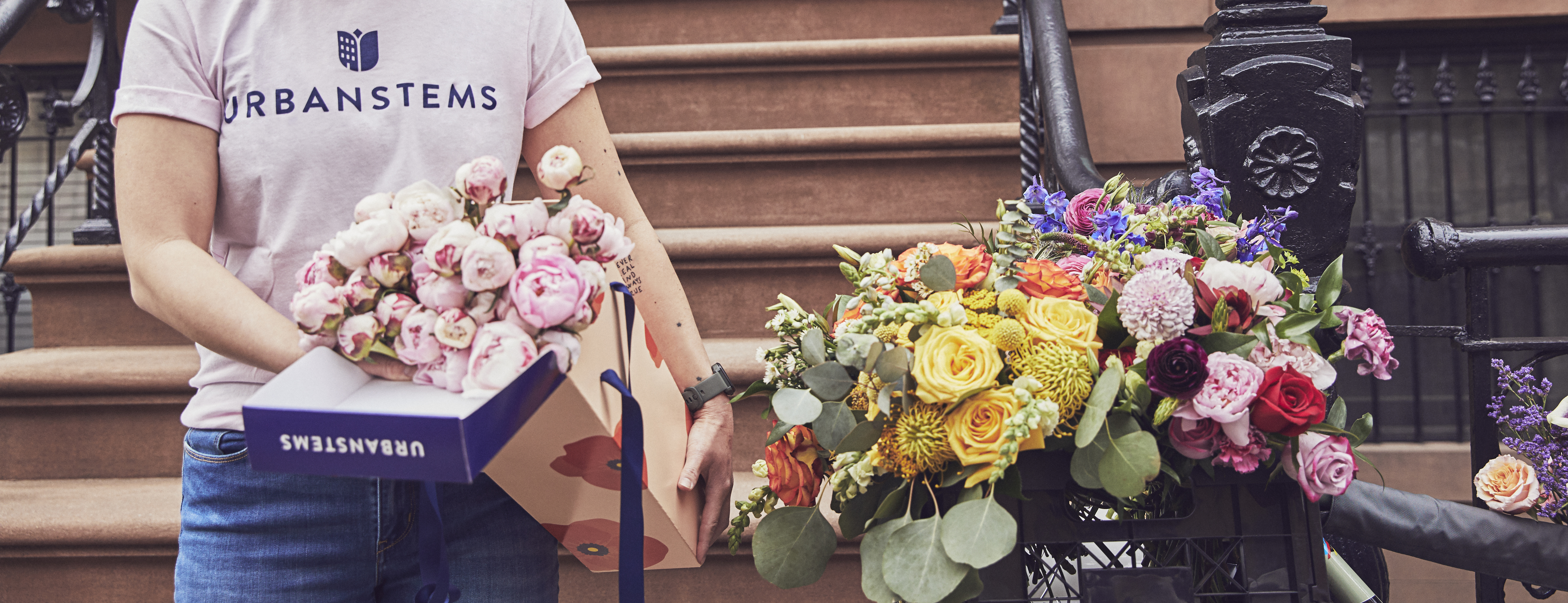 Boxes of flowers being delivered right to the doorstep via UrbanStems same-day delivery