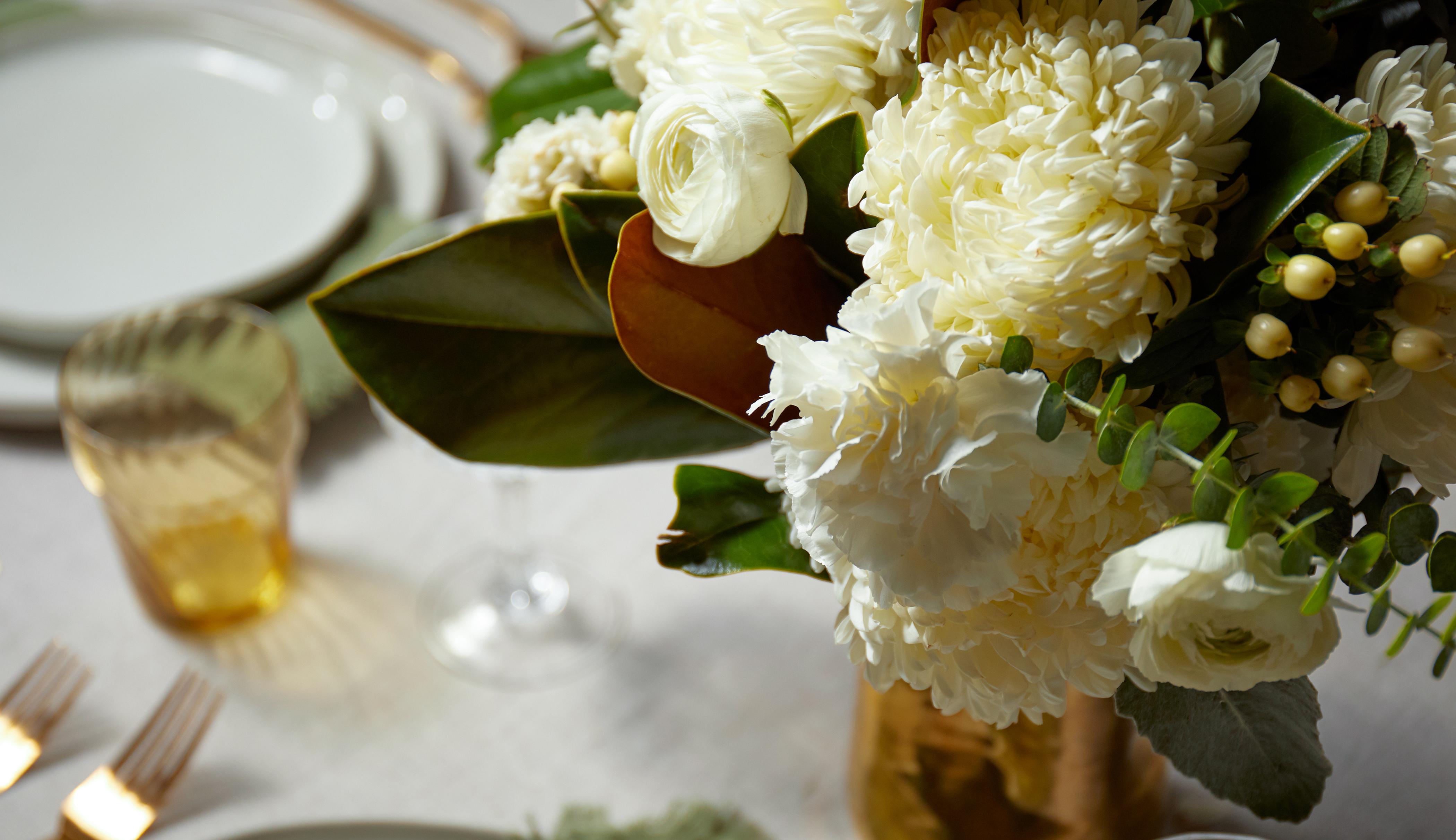 Magnolia bouquet on a set table