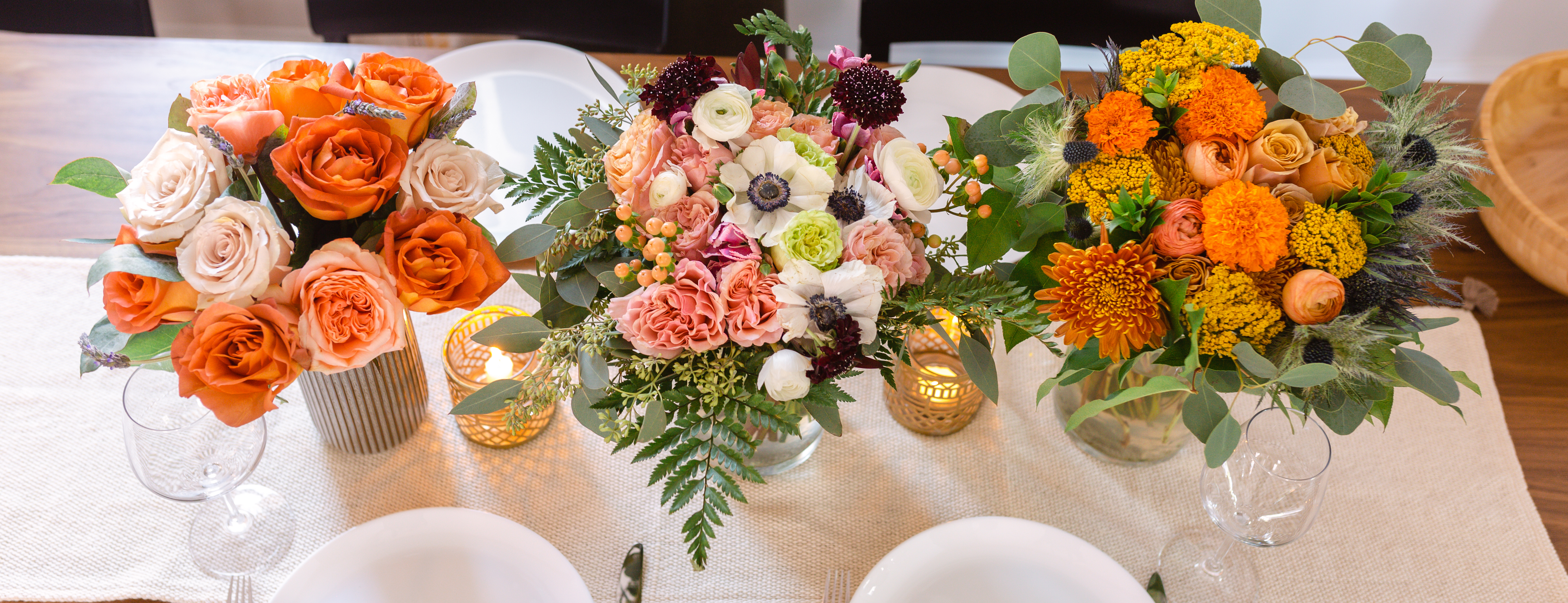 Tablescape with three summer bouquets.