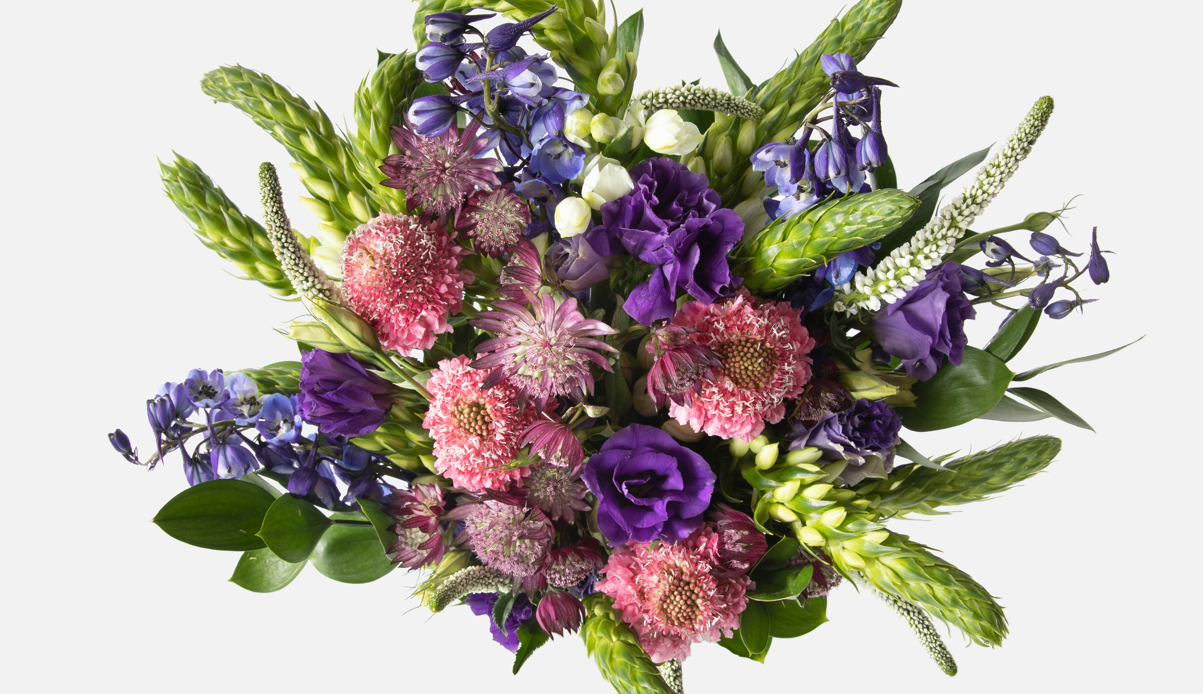 Top down view of a flower bouquet with delphiniums