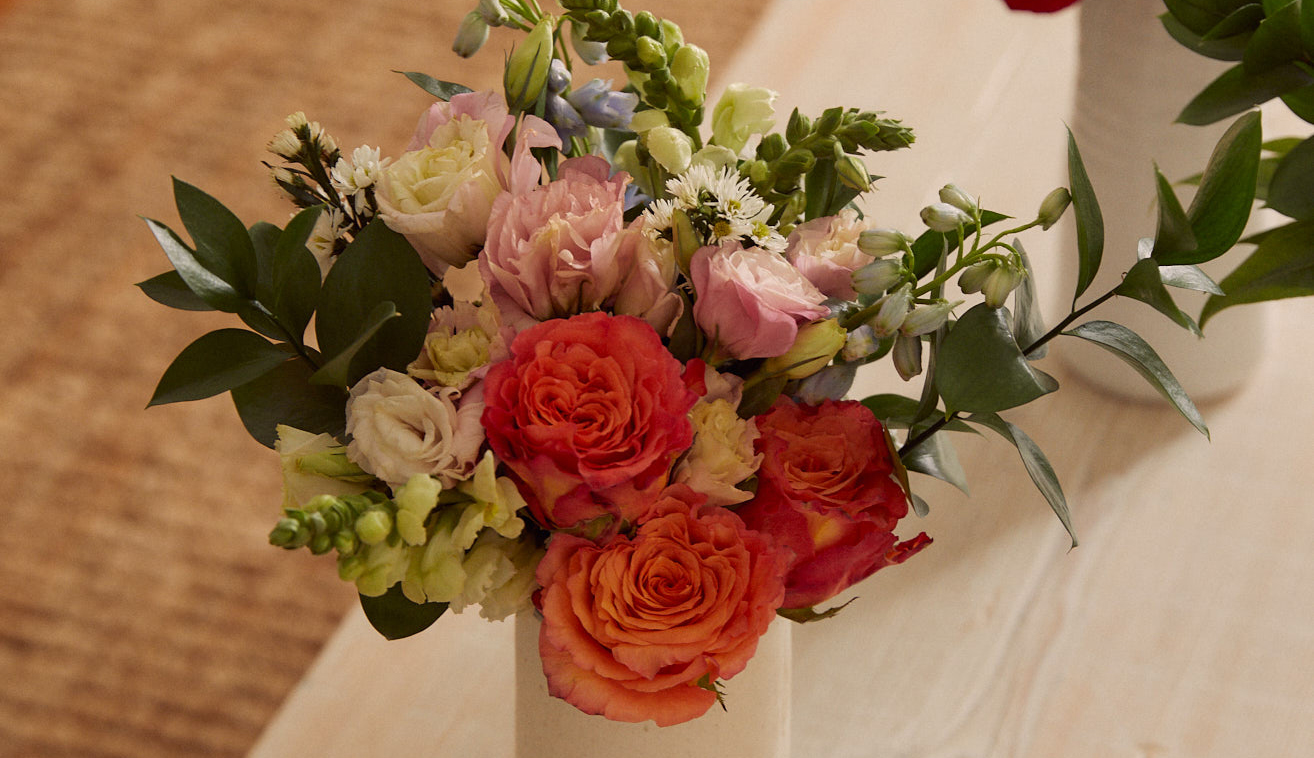 Colorful flower bouquet from Breast Cancer Awareness Collection on table