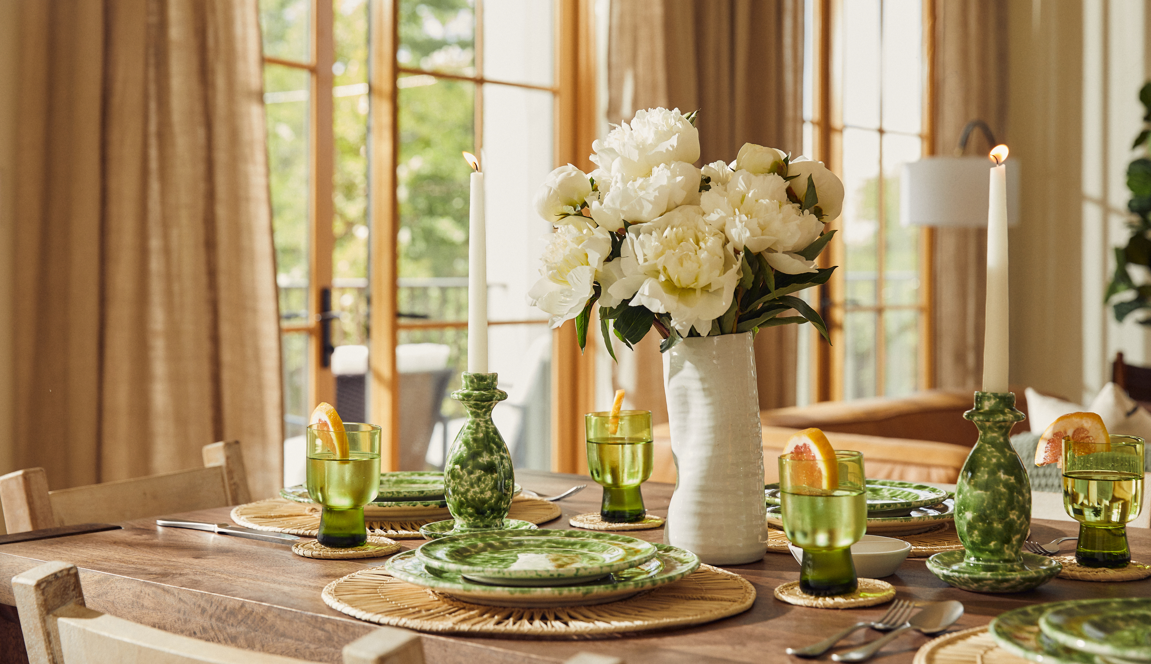 White peony bouquet on set dining table.