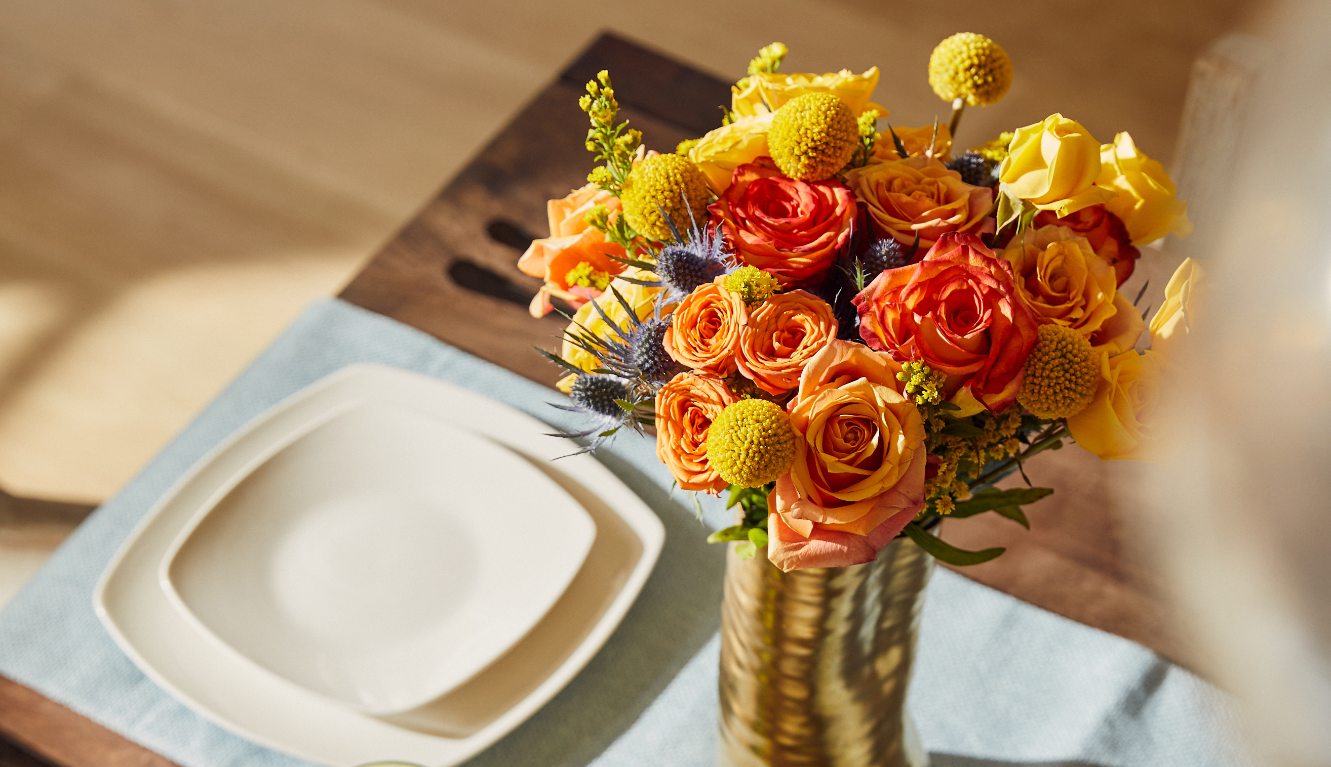 Table set with a lively summer bouquet