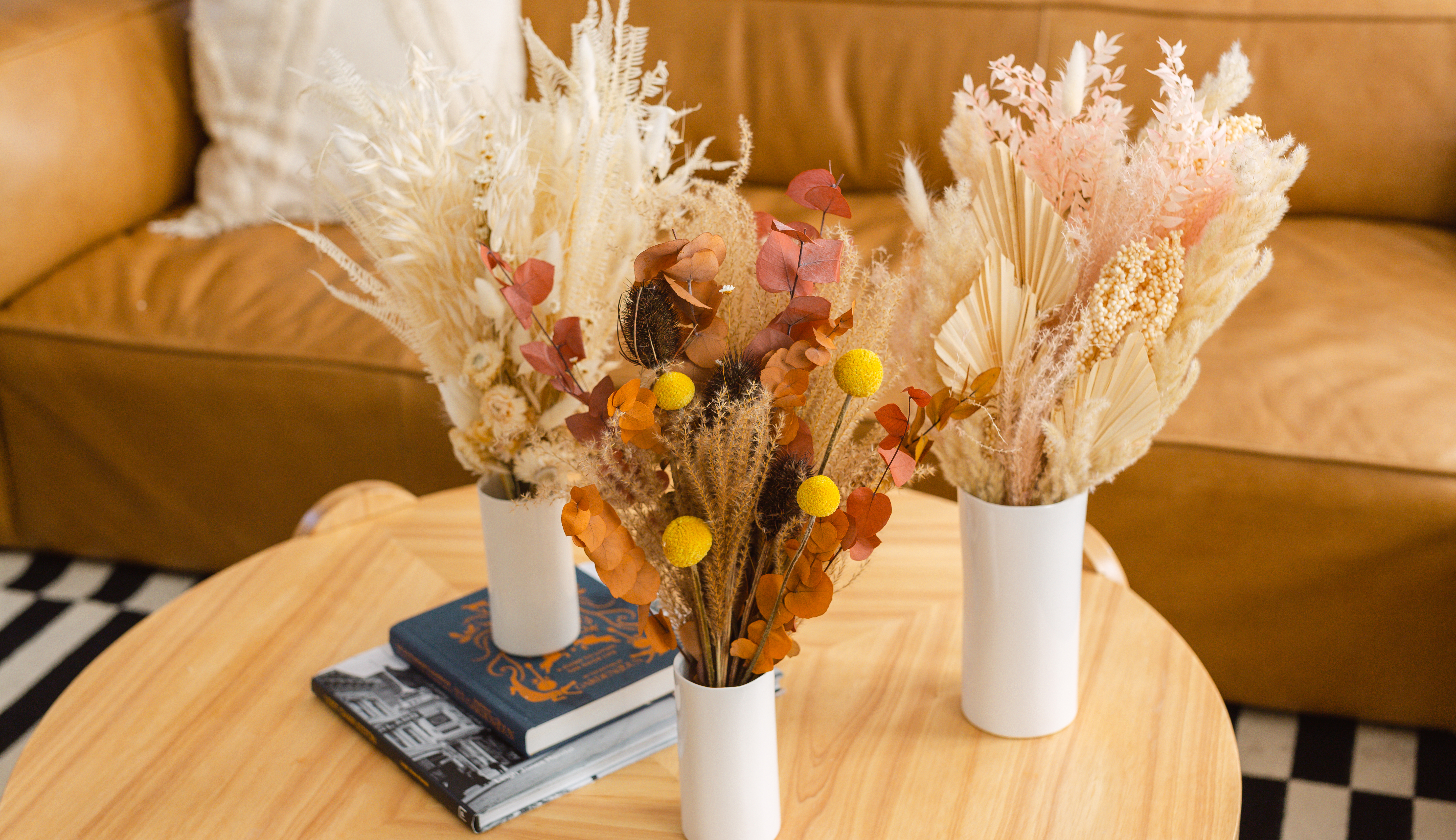 Trio of dried bouquets on a coffee table