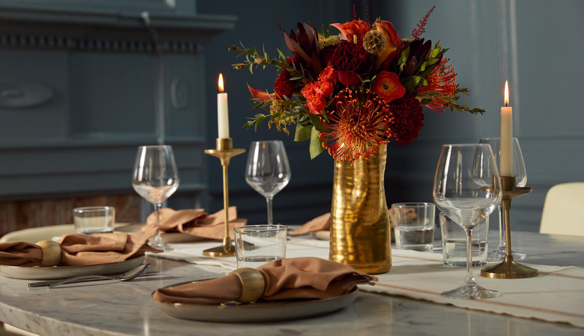 Fall bouquet serving as an autumn dinner party centerpiece